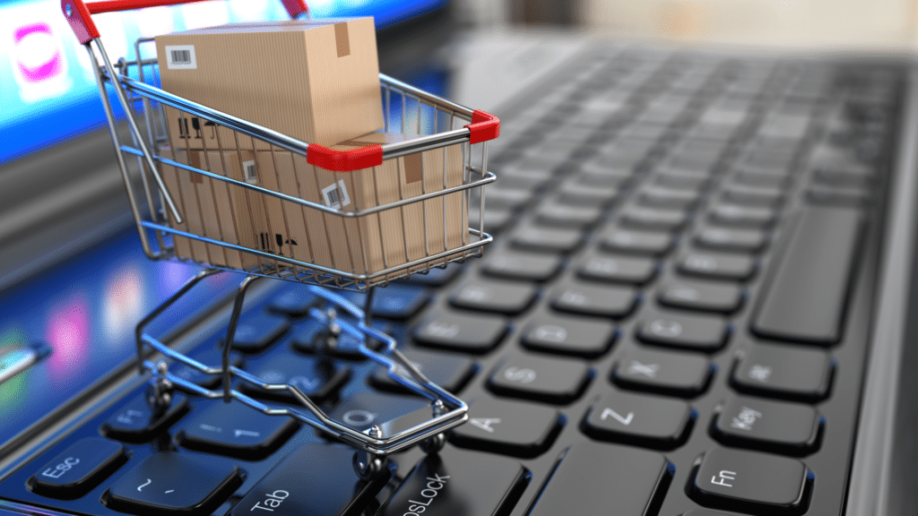 Caddie de shopping sur un ordinateur pour refleter l'image e-commerce